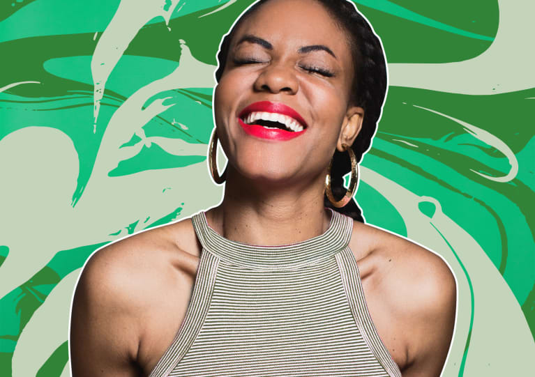 Joyful lucky woman on festive green background