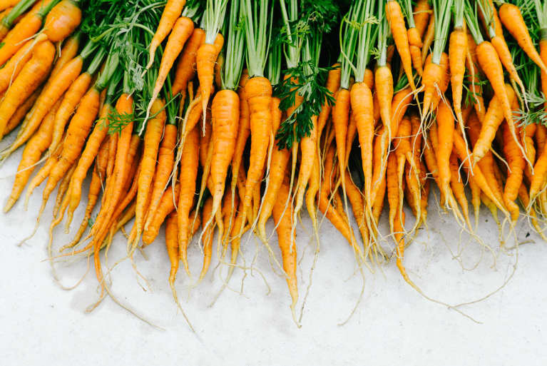 Freshly Harvested Carrots with Green Tops