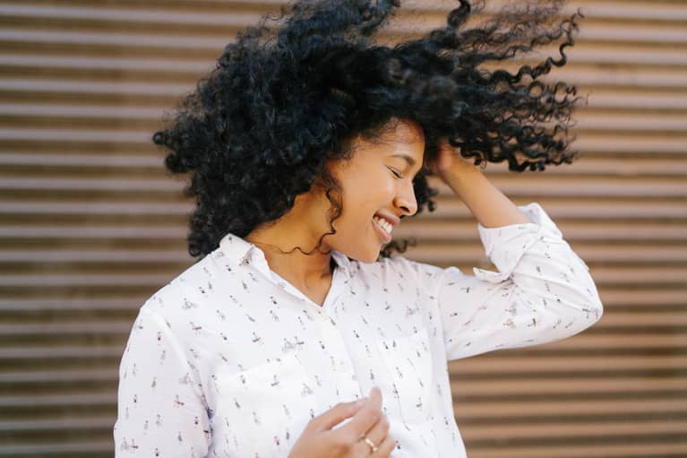 Smiling Woman Flipping Her Hair