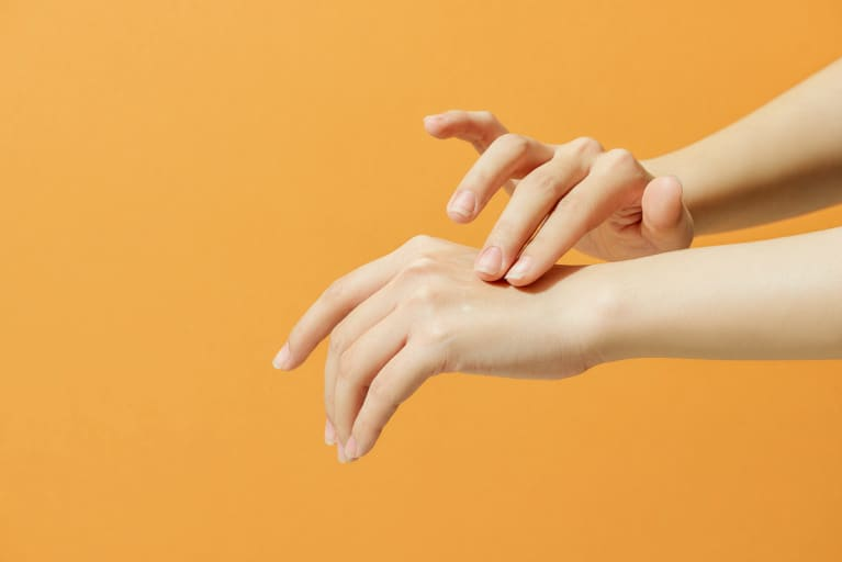 Hands Applying a Cream