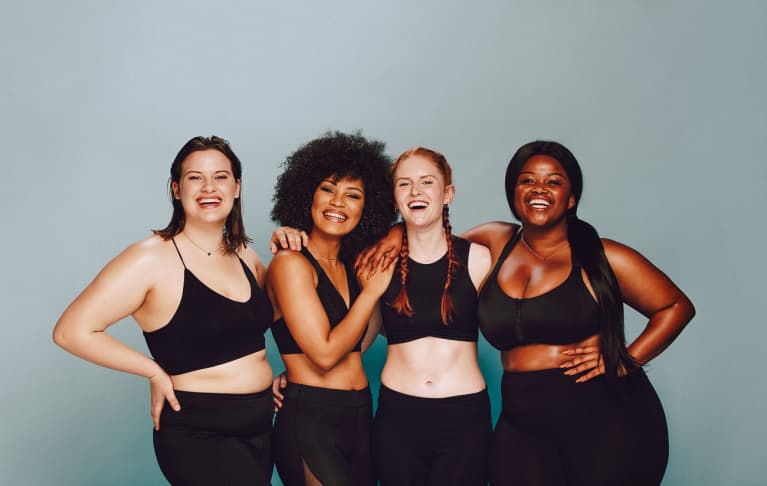 Group of Women With Different Body Types in Workout Gear