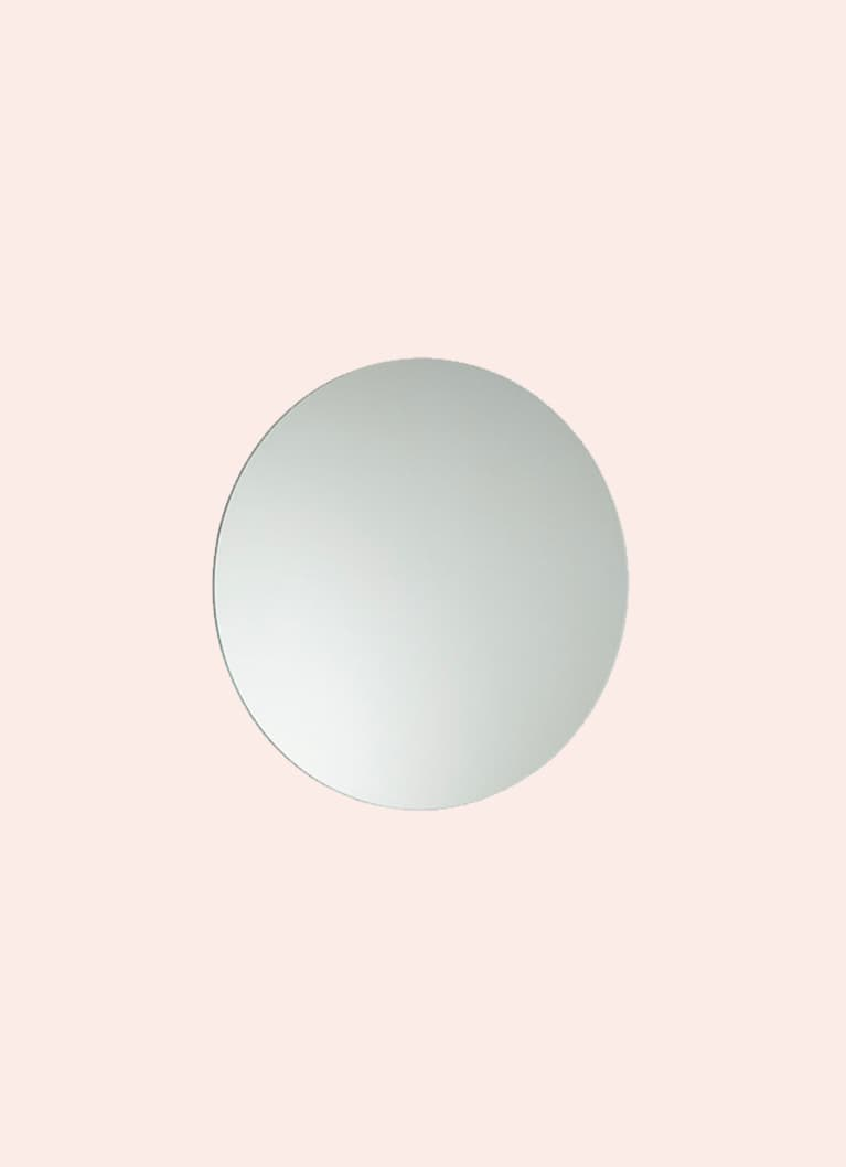 circular mirror on pink background