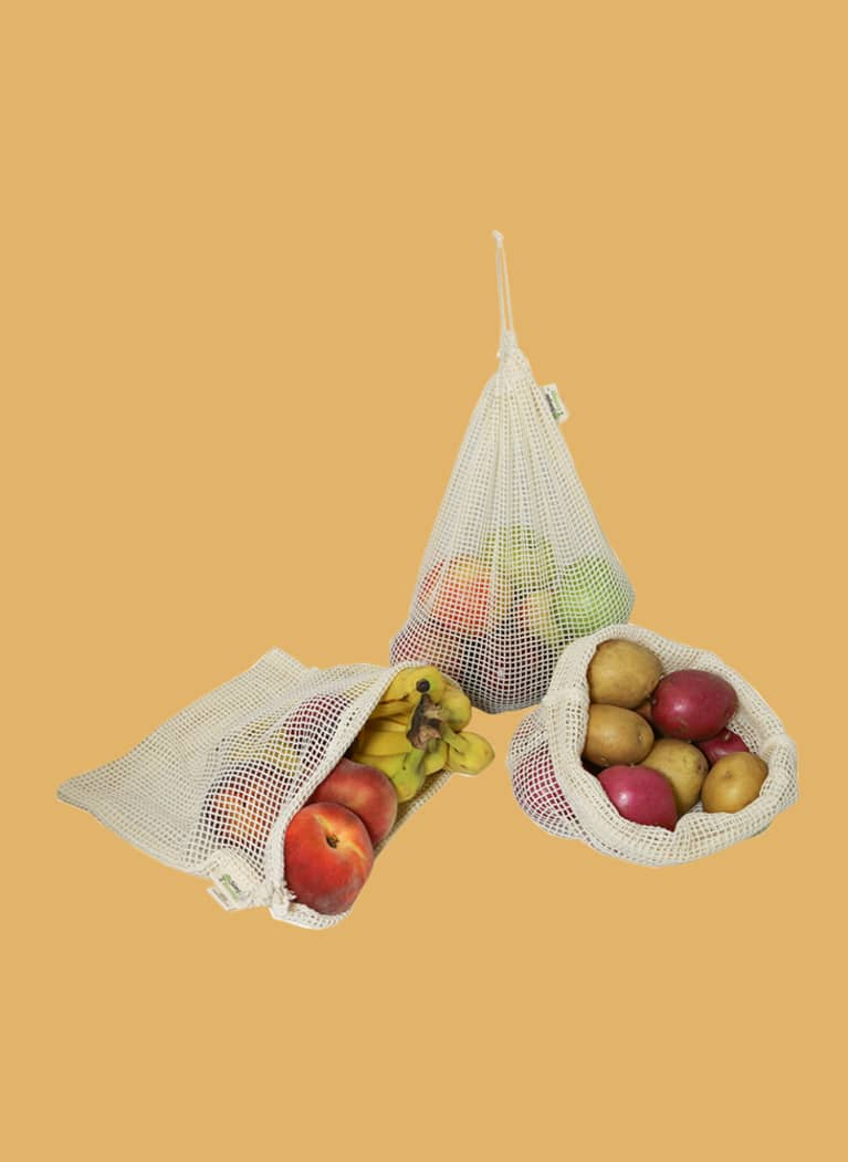 Simple Ecology small mesh paroduce bags filled with apples and bananas