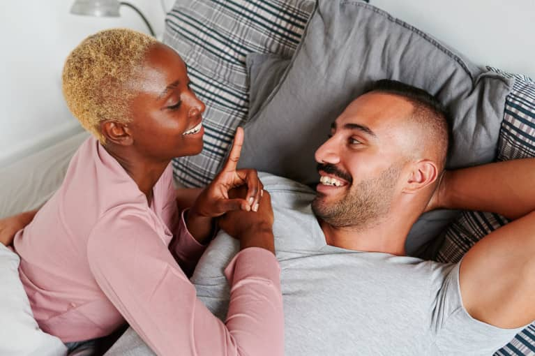 Couple Smiling Together In Bed In The Morning