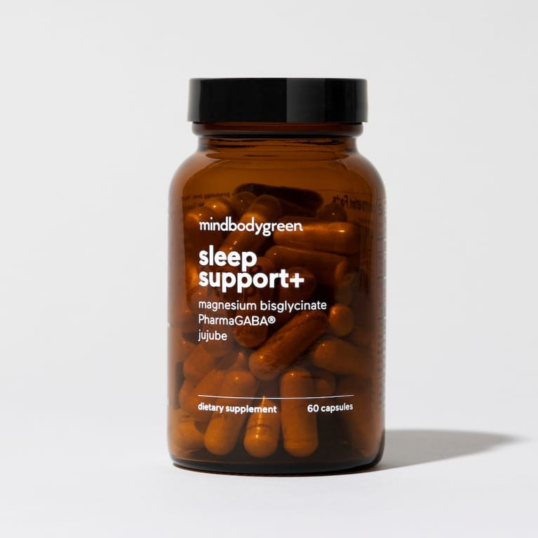 amber supplement bottle with white lettering