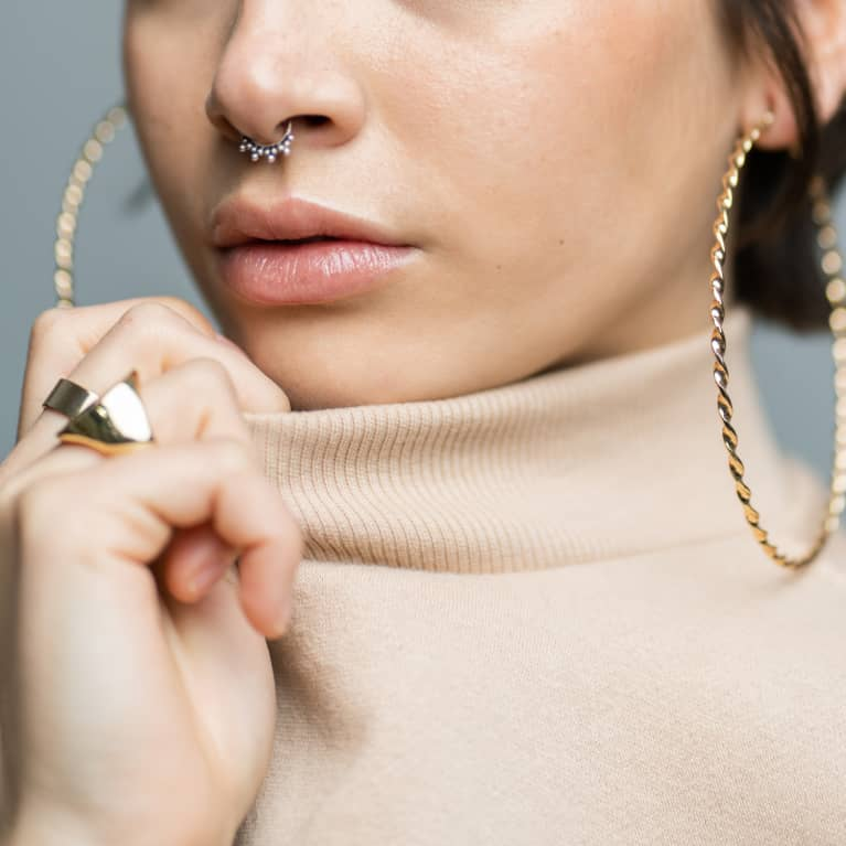 Unrecognizable Woman with Turtleneck and Gold Jewelry