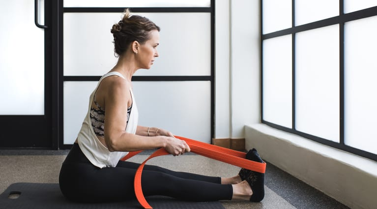 Hamstring stretch with extended spine