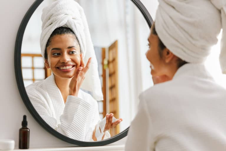 Woman at home, skincare routine with face mask