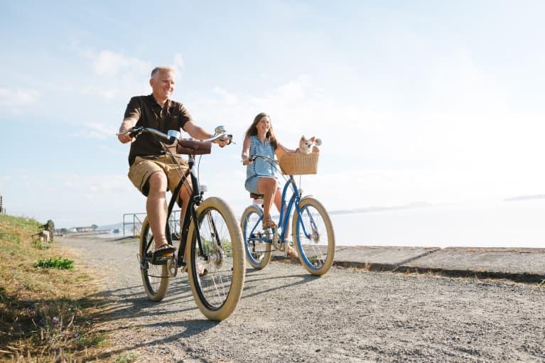 Couple in their 50s riding their bikes