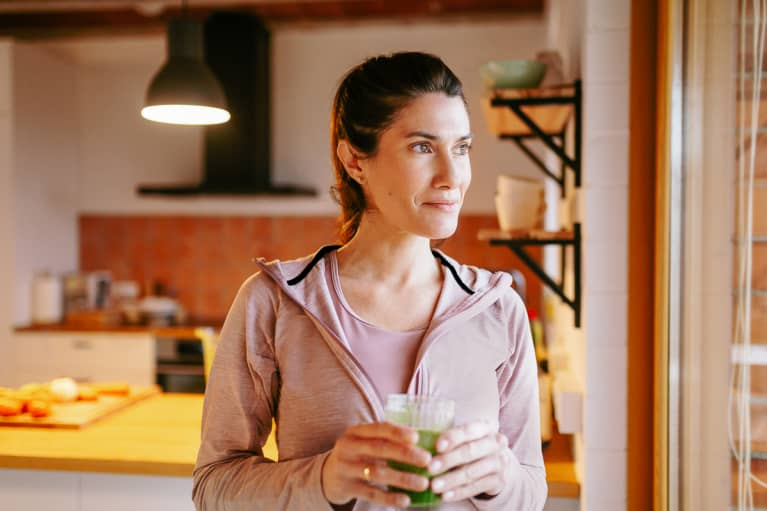 Woman Drinking A Smoothie At Home.