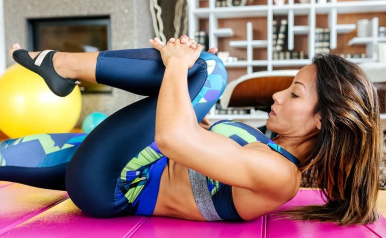 woman working out on mat at home