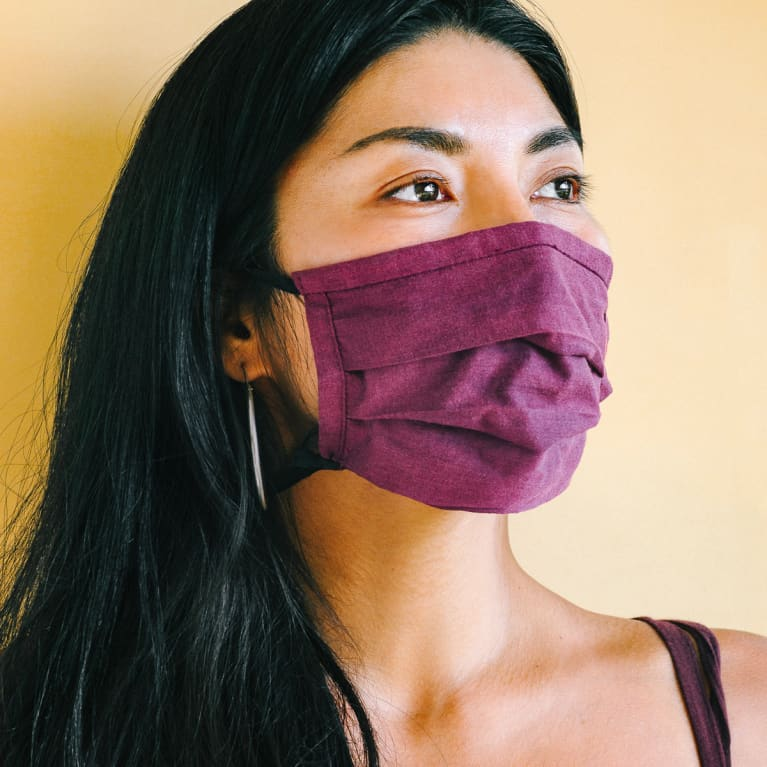 Young Woman Wearing a Purple Cloth Face Mask