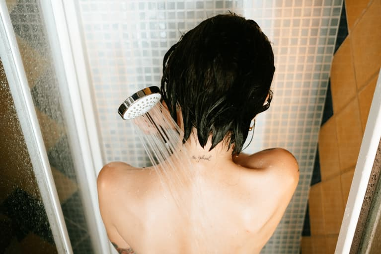 Back of a Woman Taking a Shower