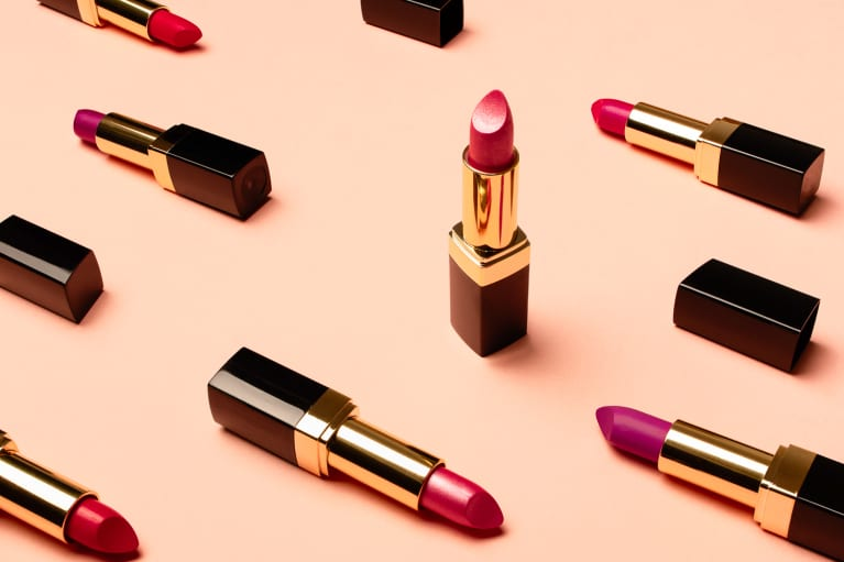 Variety of Red Lipsticks on a Peach Background
