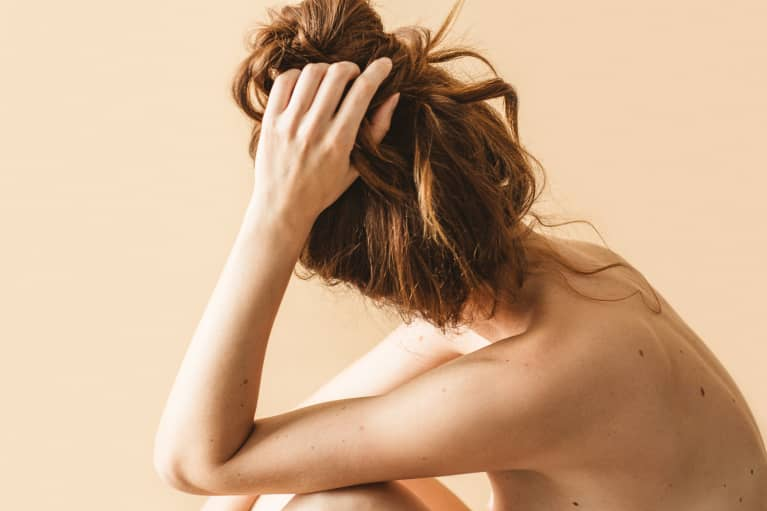 Unrecognizable Beauty Shot of a Woman with Hair in a Bun