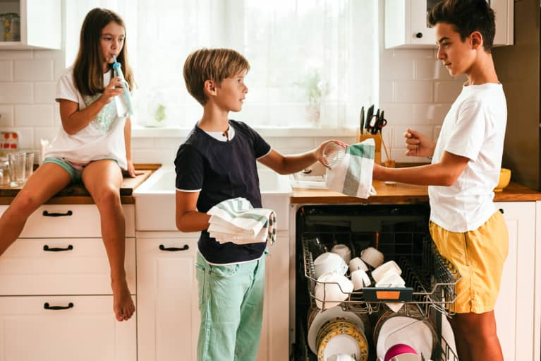 Three Kids Doing Chores in the Kitchen