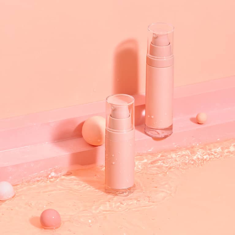 Generic Pink Beauty/Skin Care Bottles in a Minimal Studio Set