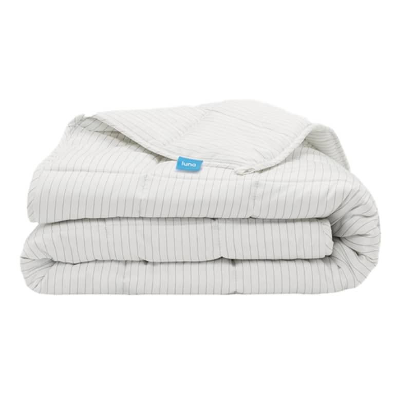 White bamboo weighted blanket with thin grey stripes, folded.
